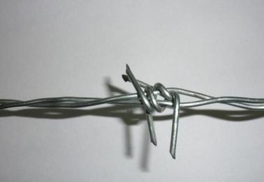 China PVC Coated Barbed Wire Security Fence , Galvanized Steel Barbed Wire 12# 14# 150 M Per Roll factory